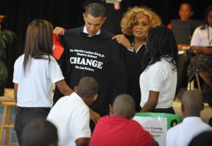 President Obama receives a t-shirt from New Orleans charter students. Madel Ngan/AFP/Getty Images