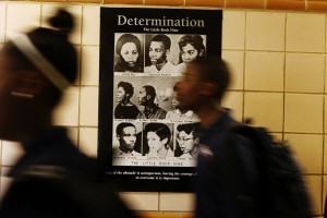 NYC charter students pass a poster of the Little Rock Nine, recalling the events that led to public school desegregation. Photo by Emily Berl.