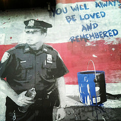 Ironically, graffiti memorializes Officers Liu and Ramos in NYC. Photo by A. Golden via Flickr CC.