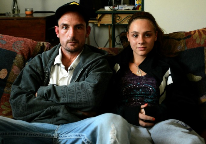 "Before her senior year in high school, Raven moved back in with her father, Michael Gribbins. A recovering cocaine addict and alcoholic, he had been sober for several years and became more involved in Raven's life. ""This is probably the only year that I'm going to have to spend it with my daughter,"" he says, ""so I feel lucky that I got this opportunity."" Though he made it through the 11th grade, Michael never learned to read and write, and he works as a maintenance man. ""Not having an education, sometimes work's hard to find,"" he says. ""You struggle."" Photo by Stacy Doose. © 2013, Amy Scott."