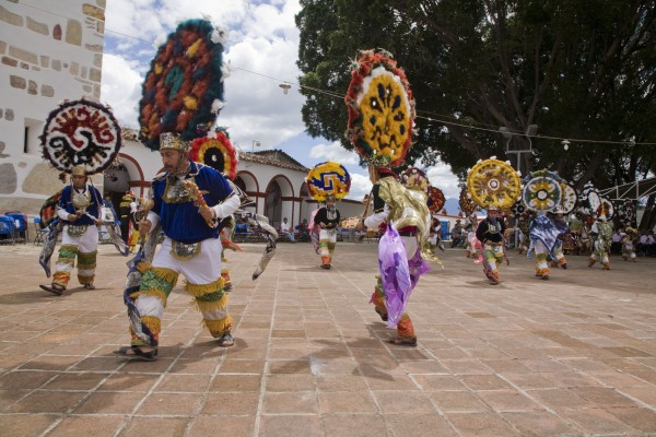 "The name of the city, Teotitlán, comes from Nahuatl and means ""land of the gods"". Its Zapotec name is Xaguixe, which means ""at the foot of the mountain"". It still retains its Zapotec culture and language. The dance is performed in the town plaza in front of the Preciosa Sangre de Cristo Church, begun in 1581 and completed in 1758. The church sits on the ruins of a Zapotec temple, which the Spanish destroyed."