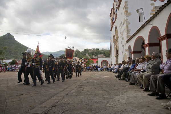 Children representing the soldiers of Cortes march in front of the community authorities. To form alliances against the Aztecs, Cortes needed a translator. First he found a priest who could speak Mayan, then a Nahuatl woman from the Gulf Coast who could translate between Mayan and Nahuatl, the language of the Aztecs and surrounding peoples. Malinalli, or Doña Marina, was one of 20 women given to the Spaniards by the residents of Tabasco. She became Cortes' lover and advisor, and bore Cortes' first son, Martin.