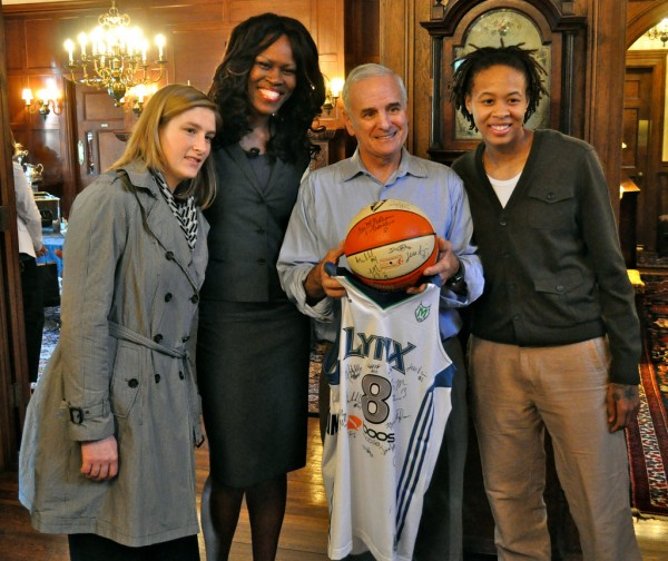 Minnesota Governor Mark Dayton poses with WNBA players Lindsay Whalen, Taj McWilliams-Franklin, and Seimone Augustus in 2011. Whalen and Augustus would play alongside Breanna Stewart on the 2016 Olympic gold-winning U.S. women's basketball team. Office of Governor Mark Dayton