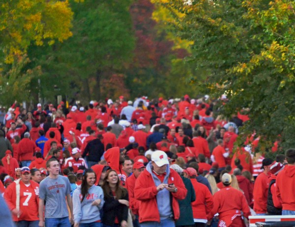 A sea of University of Wisconsin Badgers fans streams into their home stadium. Richard Hurd, Flickr CC