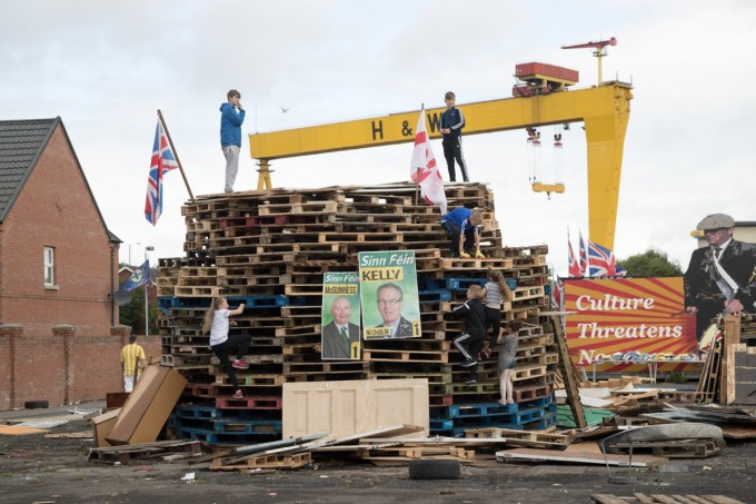 While the Union Jack and Ulster Banner will be removed before the bonfire is lit, the Sinn Féin election posters will not.