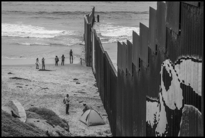 The border wall runs into the Pacific Ocean on the Mexican side. Copyright David Bacon