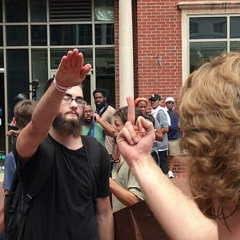 "A Nazi salute is met by a counter-protester ""salute"" in Charlottesville, 8/12/17. Evan Nesterak/Flickr CC"