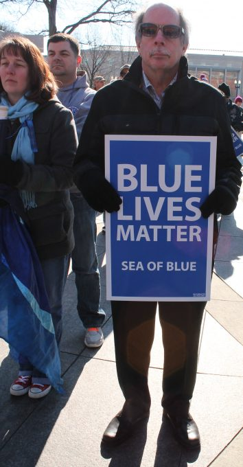 An attendee at a January 2015 End the Madness/Sea of Blue march in Washington, D.C. Photo by Elvert Xavier Barnes, elvertbarnes.com.