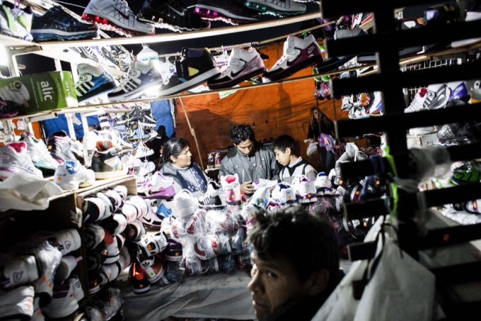 Running a sweatshop and market stall is commonly a family affair. Many immigrants—mostly Bolivian—arrive in Buenos Aires to work for a relative. Some have their passports confiscated until they can pay off the cost of their passage.
