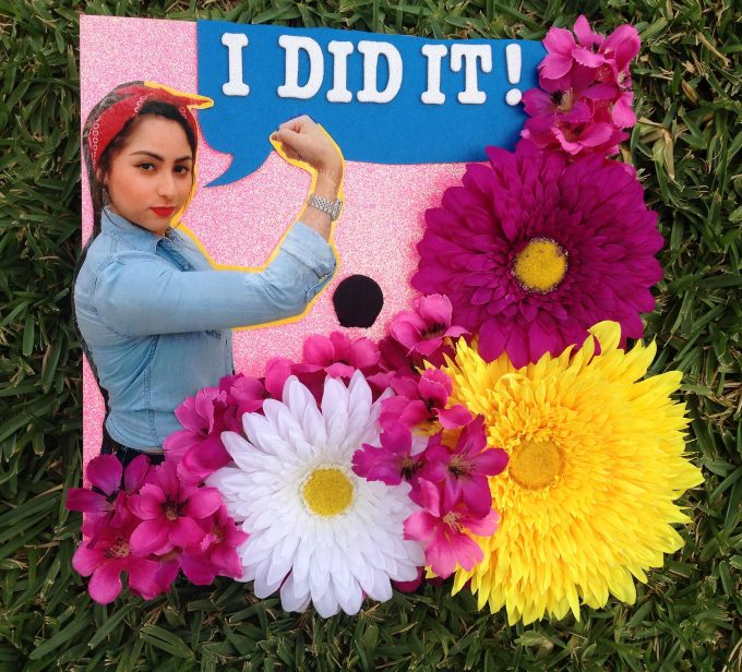 """My cap was inspired by the Rosie the Riveter... Under the Trump administration, many racist and derogatory insults have been said towards women and people of color. It is important to show unity during these hard times and show that women and people of color are capable of reaching their goals and are not criminals."""